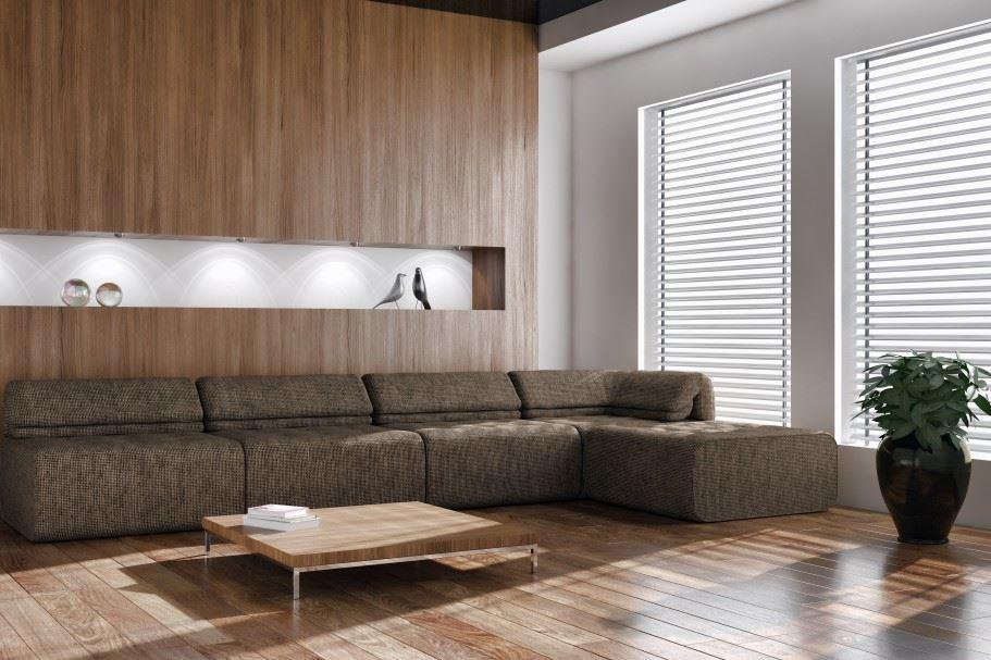 Большой модульный диван возле окна