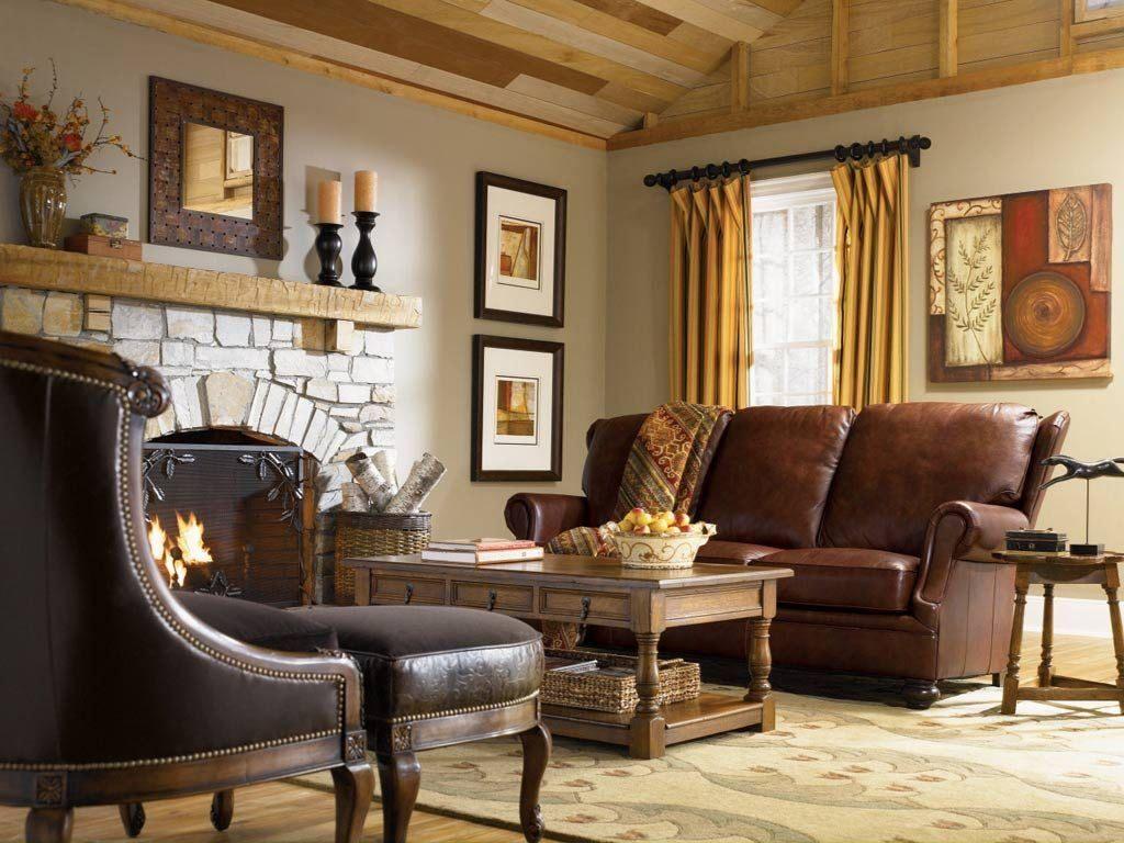 Прямой коричневый диван возле камина