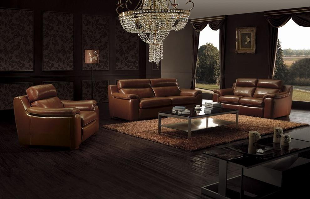 Кожаные кресла и диван коричневого цвета
