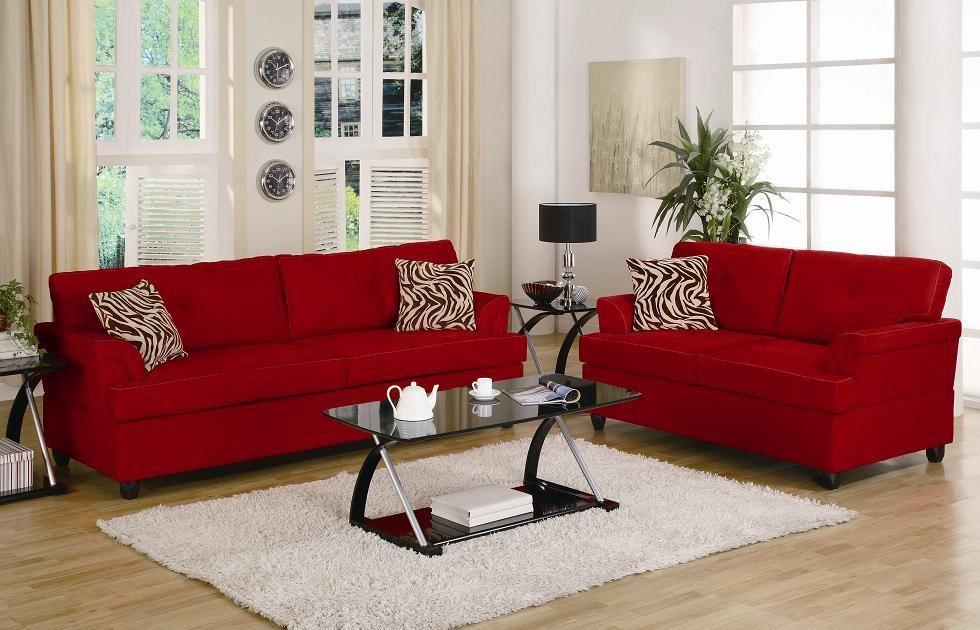 Красные диваны в интерьере дополненные комнатным растением