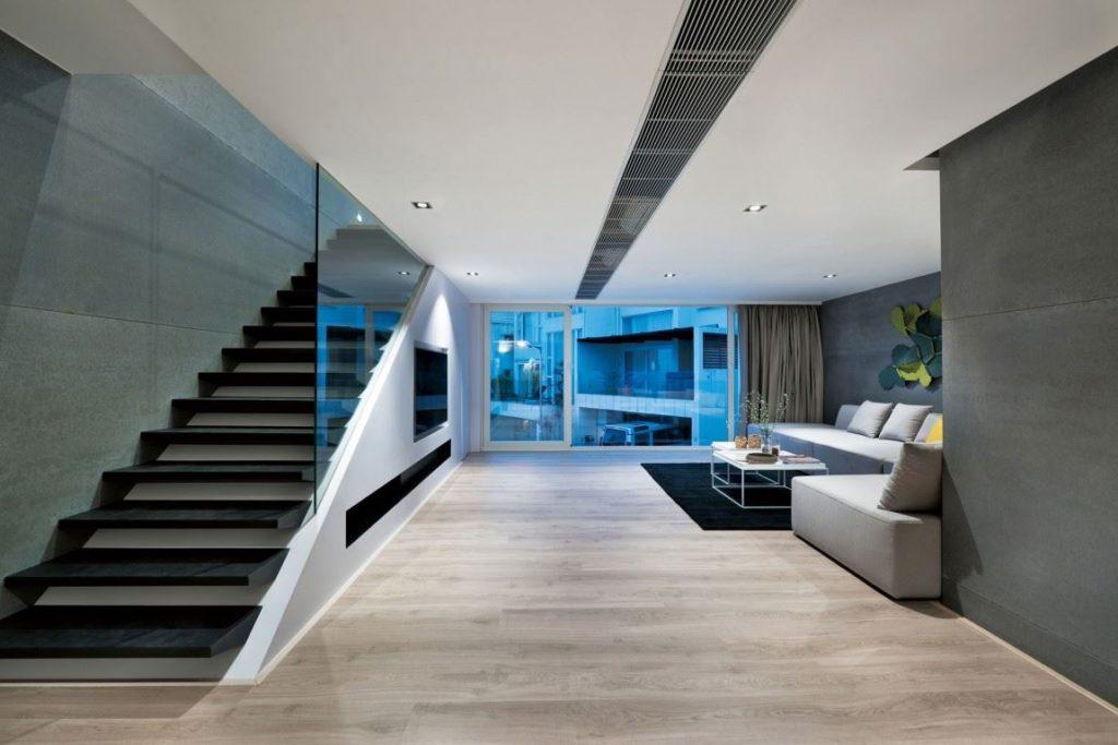 Угловой диван со спальным местом расположенный вдоль стены просторной гостиной
