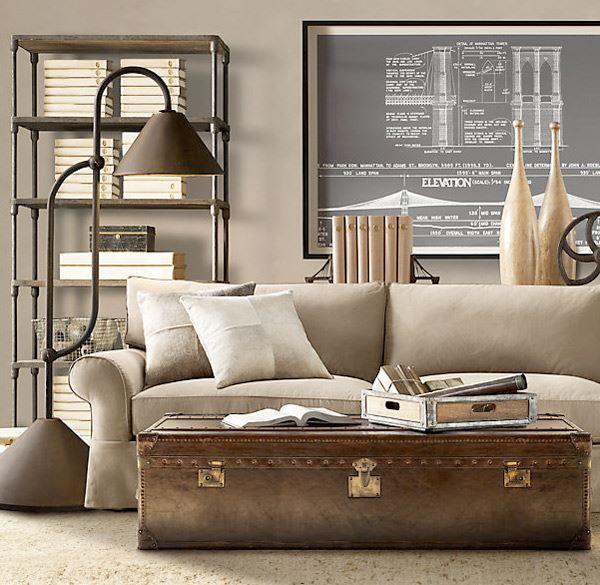 Стильный интерьер комнаты с диваном размещенным посередине