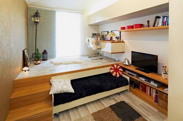 Выкатная кровать в интерьере маленькой квартиры