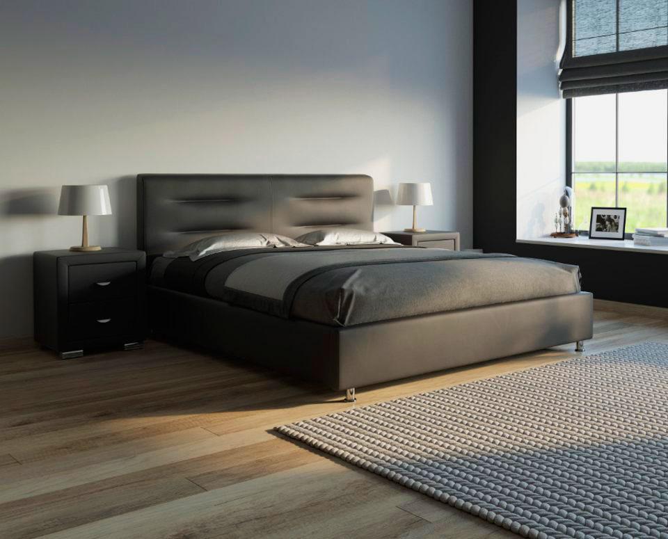 Кровать с мягким основанием в интерьере комнаты