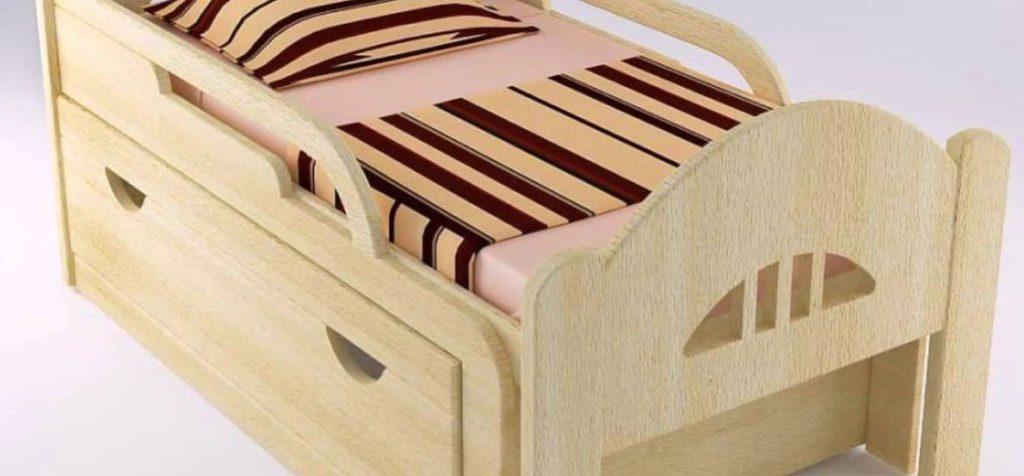 Фото деревянной растущей кровати для детей с ящиками для хранения внизу