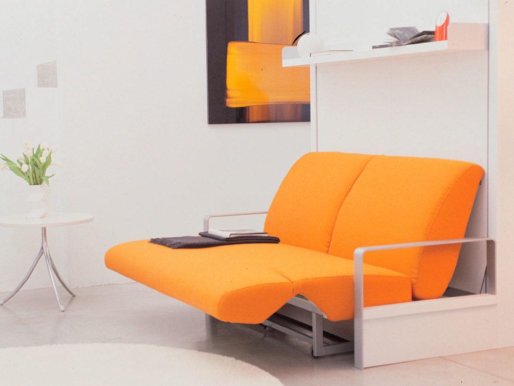 Двуспальная кровать трансформер для малогабаритной квартиры с небольшим диванчиком