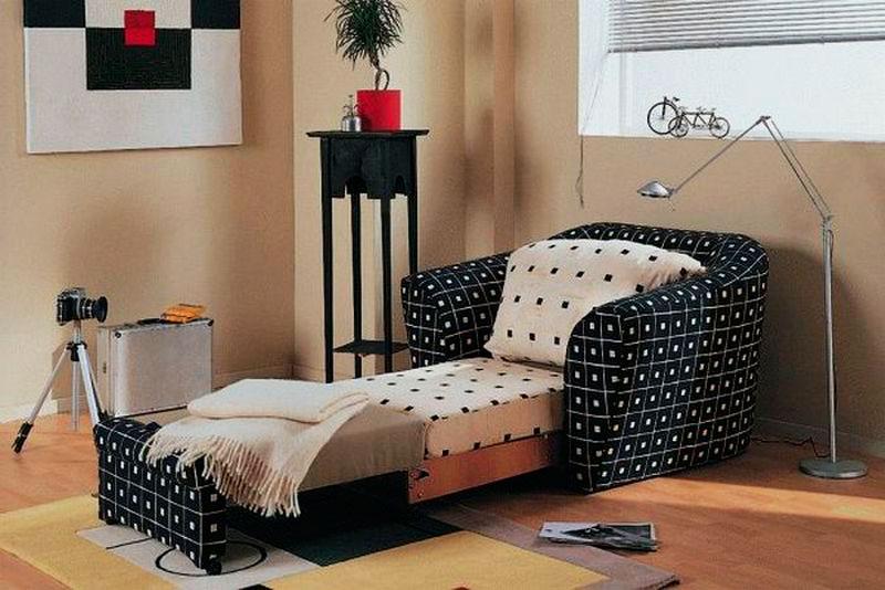 Раскладное кресло кровать в интерьере комнаты