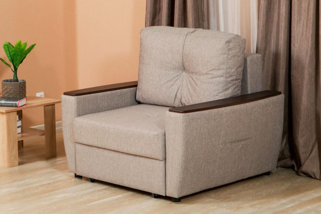 Кресло кровать в тканевой обивке с подлокотниками и подушкой