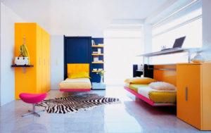 Комната подростков с трансформируемыми кроватями в интерьере
