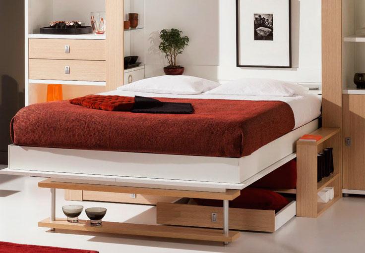 Фото двуспальной шкаф-кровати с диваном внизу оборудованным ящиками для белья