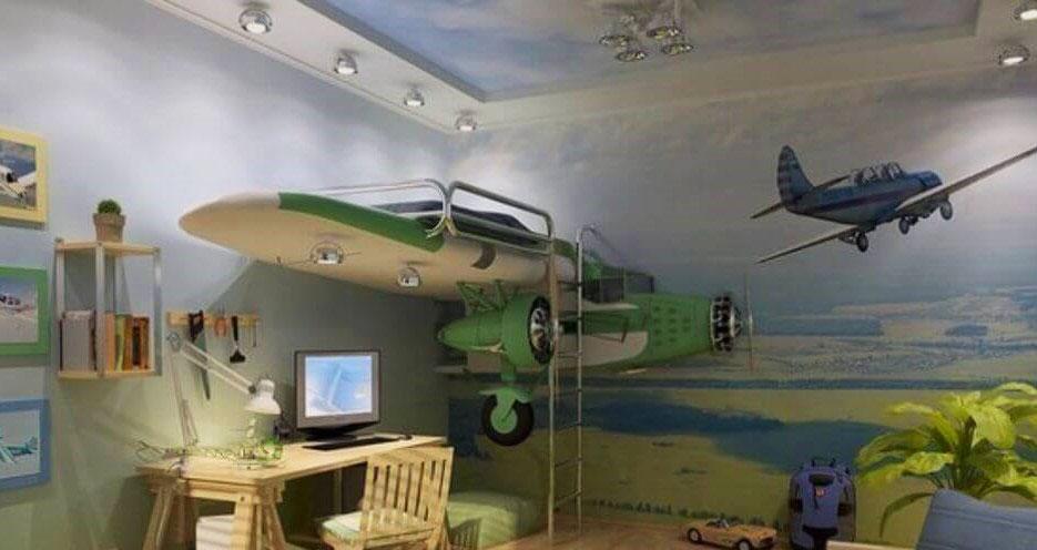 Стильная комната мальчика в авиа стиле с кроватью в виде крыла самолёта