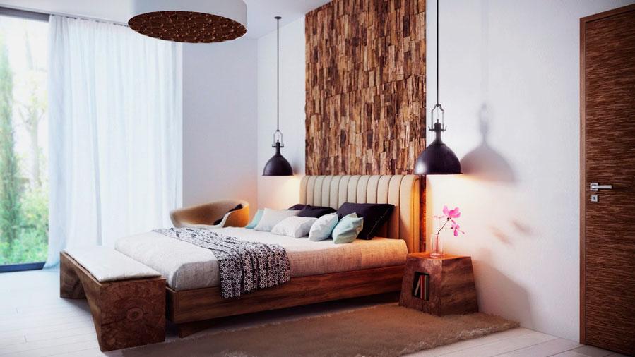 Кровать в спальной расположенная по одну стену с дверью
