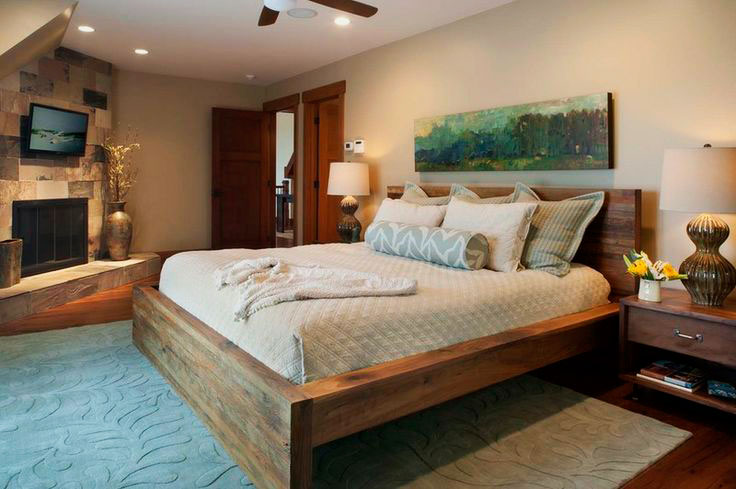 Спальная комната с камином в интерьере