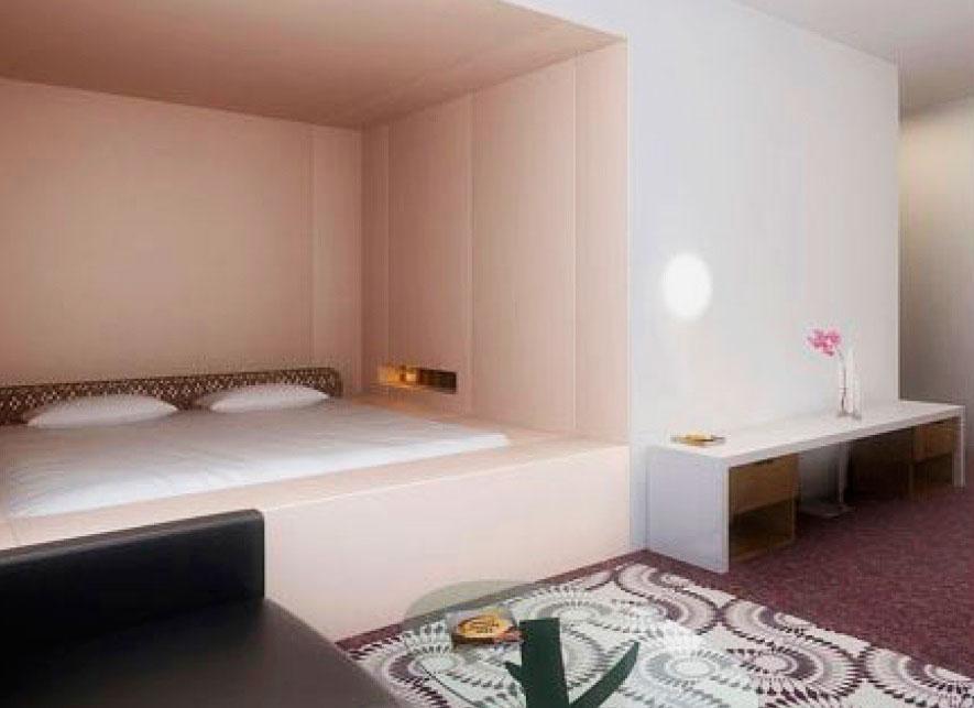 Интерьер комнаты с кроватью в стене