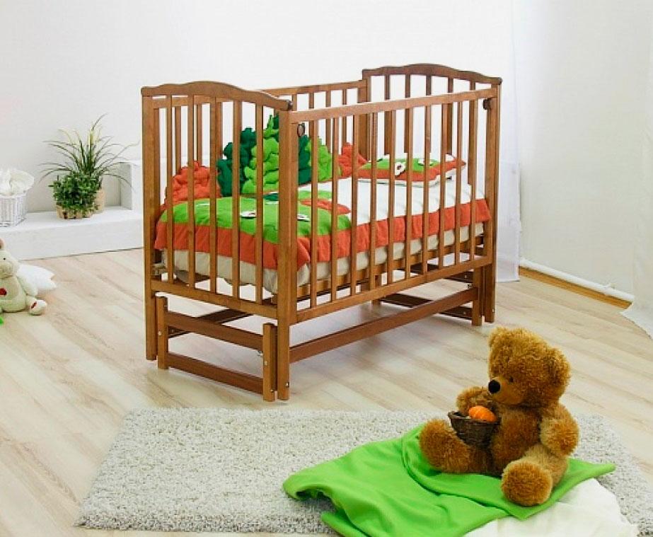 Маятниковая кровать для новорожденных