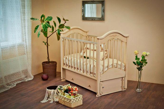 Фото детской кроватки для новорожденных с маятниковым механизмом укачивания