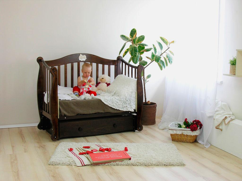 Детская маятниковая кровать со съёмным боковым бортиком