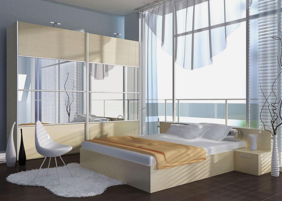 Интерьер спальной со шкафом купе с зеркальными фасадами