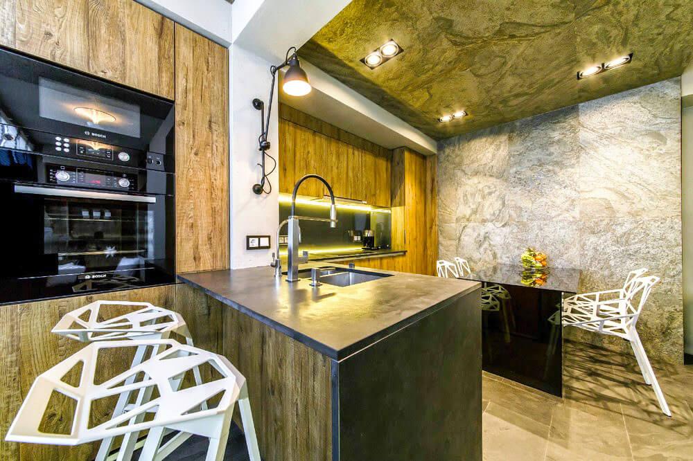 Фото кухни с компактным полуостровом со встроенной мойкой