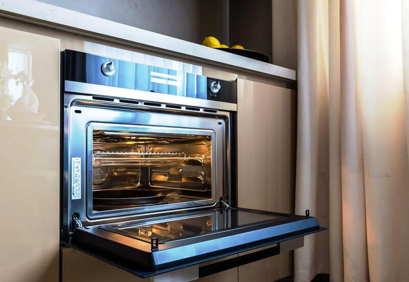 Фото духовки встроенной в кухонную тумбу