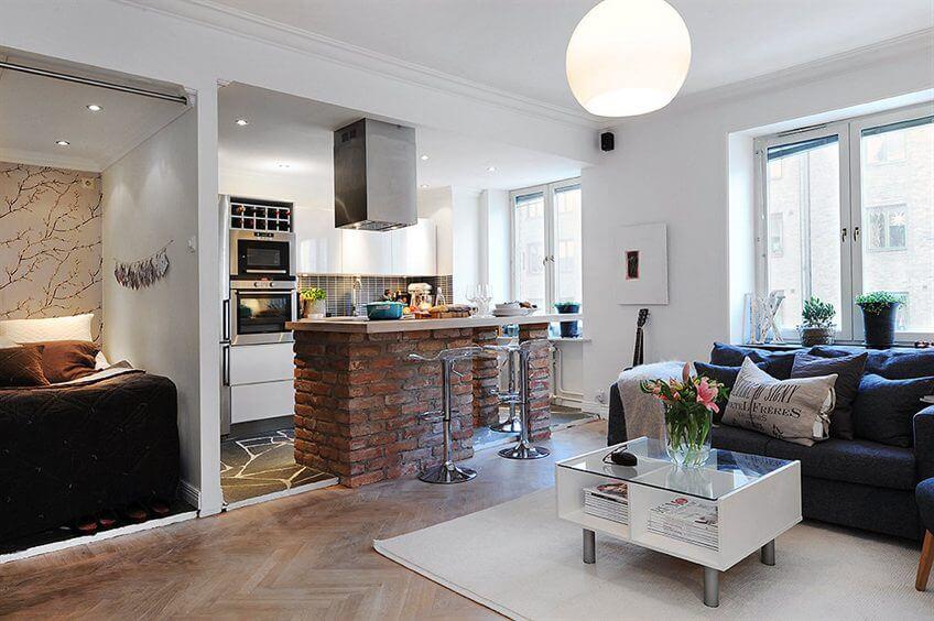 Фото студии с барной стойкой в интерьере отделяющей кухню от жилой зоны
