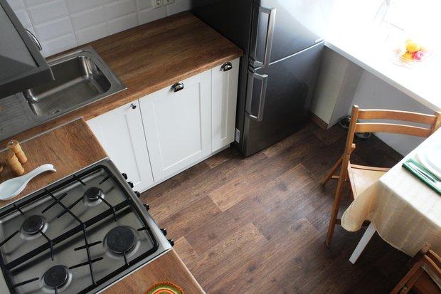 Фото удачной планировки рабочего треугольника на маленькой угловой кухне