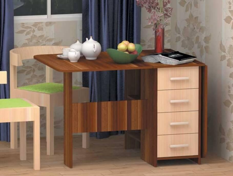 Фото кухонного стола-тумбы трансформера с двумя подъёмными столешницами и выдвижными ящиками