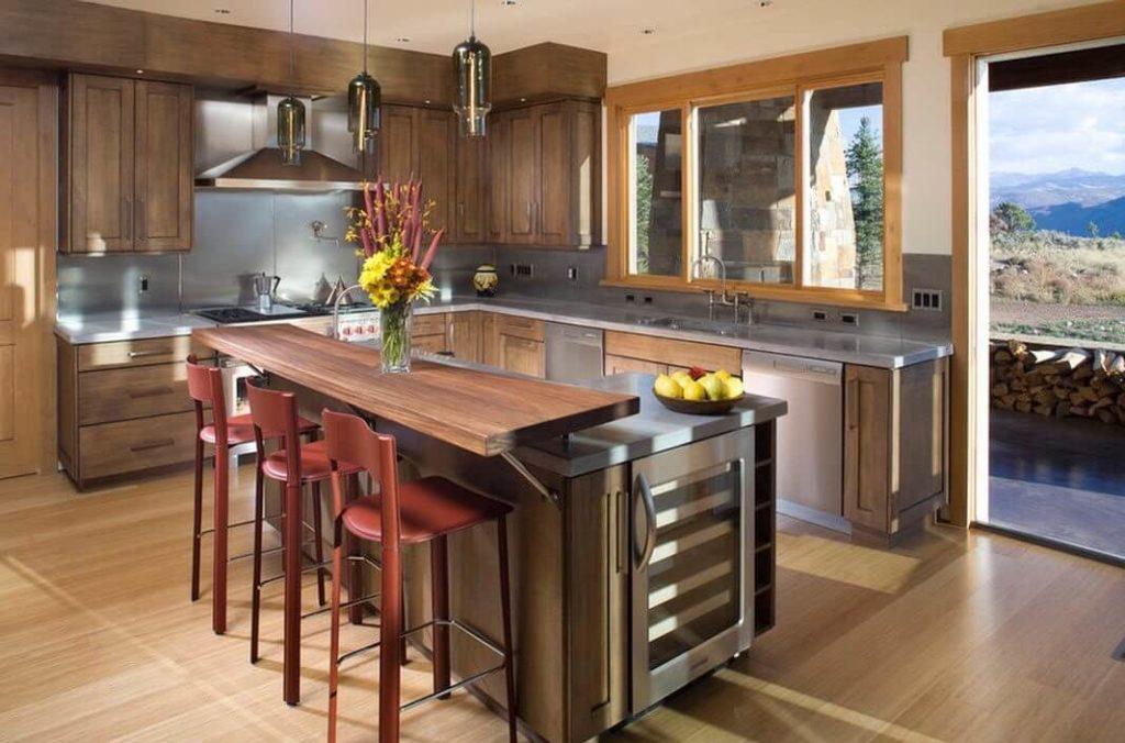 Фото угловой барной стойки совмещенной с кухонным островом