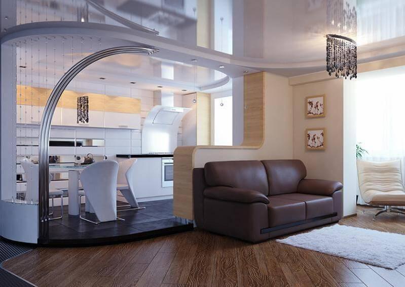 Гостинная совмещенная с кухней с барной стойкой в интерьере