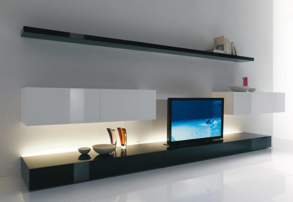 Фото длинной тумбы под телевизор во всю стену
