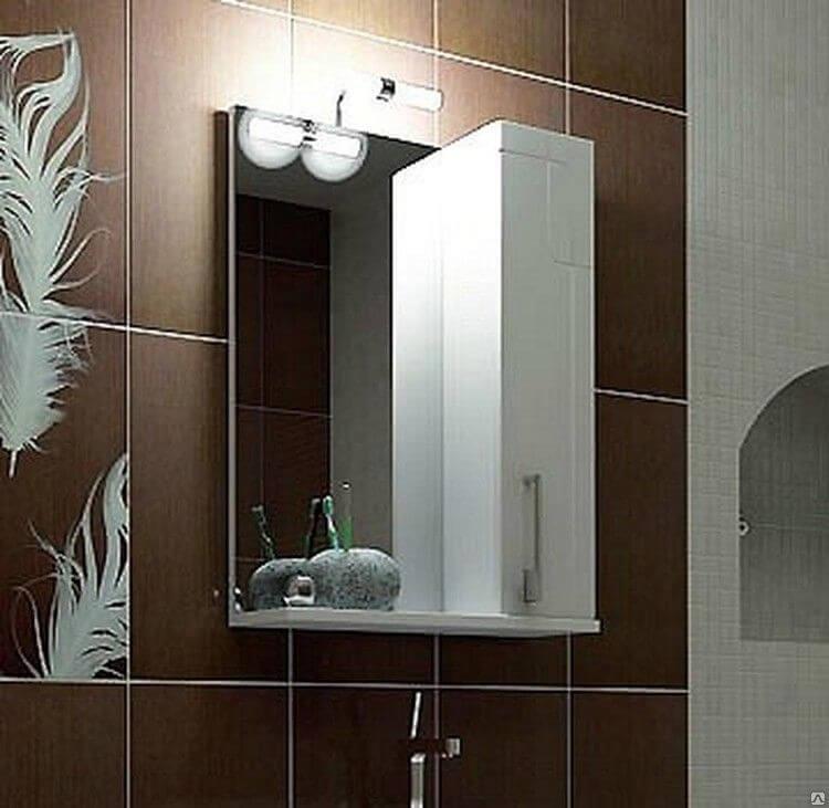 Зеркало со шкафом в ванную оснащенное подсветкой