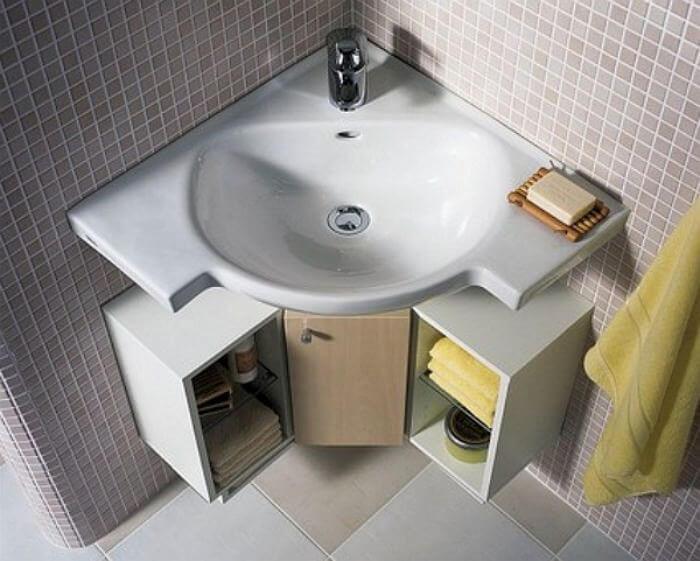 Фото угловой подвесной тумбы в ванной