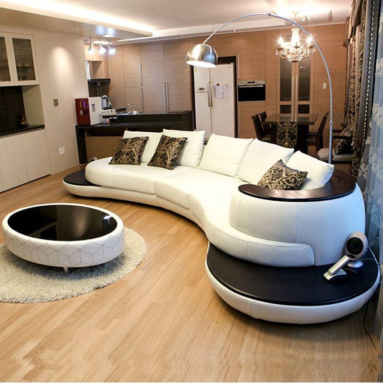 Стильный полукруглый островной диван в интерьере комнаты