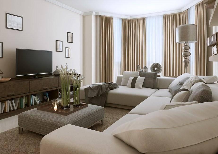 Большой угловой диван в интерьере маленькой гостиной